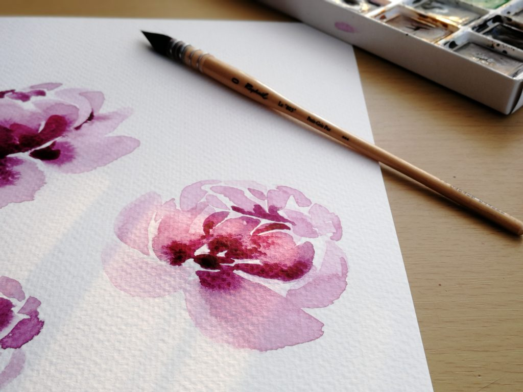 Creativity in pregnancy - A detail of a watercolour painting of a purple peony flower